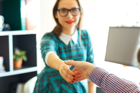 arm extended: Modern young  business woman with arm extended to handshake Stock Photo