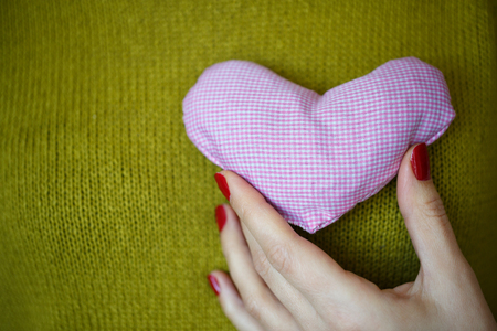 amorous woman: Closeup on pink heart in hand of woman. Image of Valentines day Stock Photo