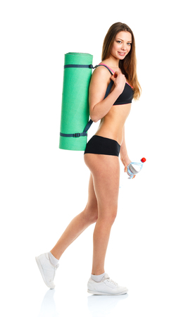 woman in water: Beautiful sport woman with mat for fitness and bottle of water isolated on white background Stock Photo