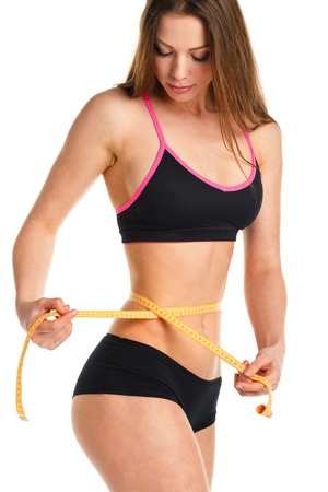 cintas metricas: Pretty woman measuring perfect shape of beautiful waist, healthy lifestyles concept