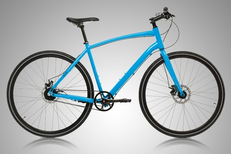 shocks: New blue bicycle on a grey background