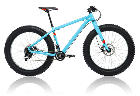 off road biking: New blue bicycle with thick tires for snow ride isolated on a white background Stock Photo