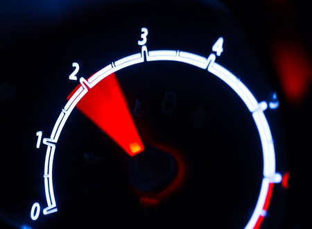 accelerated: Tachometer illuminated at night, motion look Stock Photo