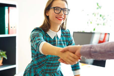 arm extended: Modern young business woman with arm extended to handshake