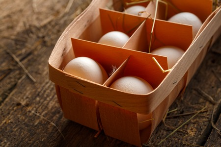 product range: Fresh chicken eggs on a wooden rustic background