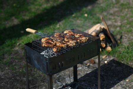chiken: Delicious grilled chiken meat over the coals on a barbecue