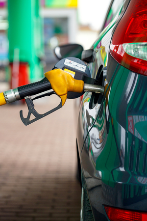 refueling: Car refueling on a petrol station closeup Stock Photo