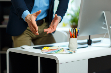 arm extended: Modern young business man with arm extended to handshake Stock Photo