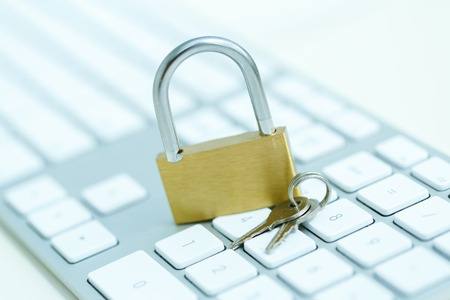 security breach: Security lock on white computer keyboard - computer security breach concept Stock Photo