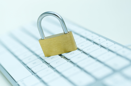 breach: Security lock on white computer keyboard - computer security breach concept Stock Photo