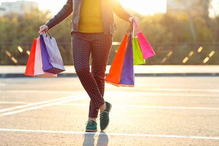 go to the shopping: Woman holding her shopping bags in her hand - Lets go shopping concept