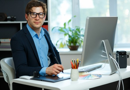 casual business man: Handsome young man working from home office - modern business concept Stock Photo