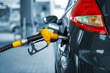 Car refueling on a petrol station closeup Standard-Bild