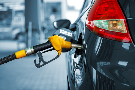 Car refueling on a petrol station closeup Foto de archivo