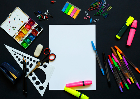 School supplies on blackboard background ready for your design - concept back to school Stock Photo
