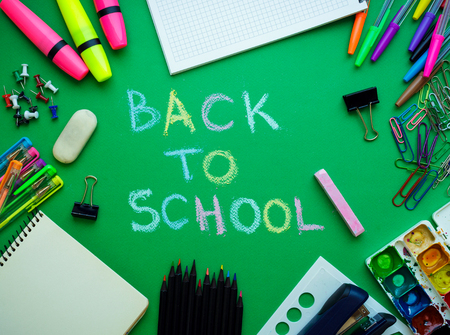 School supplies on blackboard background ready for your design - concept back to school Standard-Bild