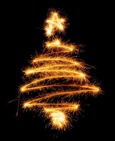 Christmas tree made by sparkler on a black background