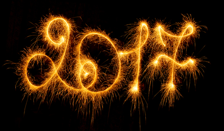 Happy New Year - 2017 made by sparklers on black background