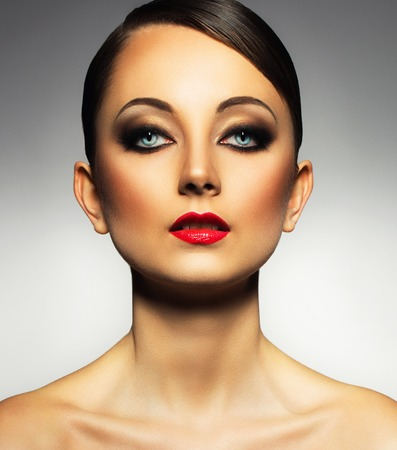 Portrait of a beautiful young woman with a glamorous retro makeup photo
