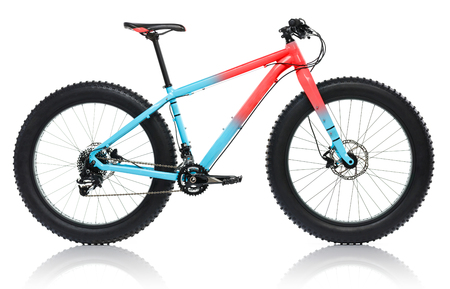 traction: New blue with red bicycle with thick tires for snow ride isolated on a white background