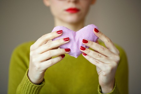Closeup on pink heart in hand of woman. Image of Valentines day Stock Photo