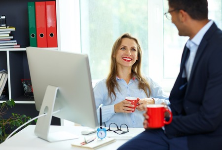 Beautiful young woman and man working from home office - modern business concept Stock Photo