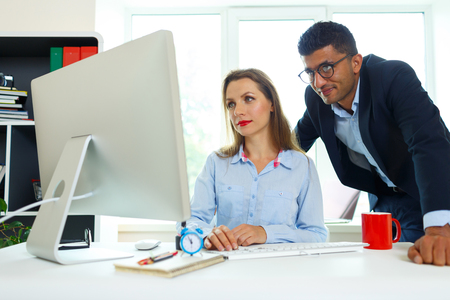 telecommuting: Beautiful young woman and man working from home office - modern business concept Stock Photo