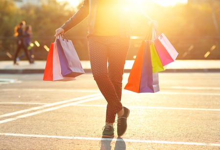 Woman holding her shopping bags in her hands - Lets go shopping concept Stock Photo