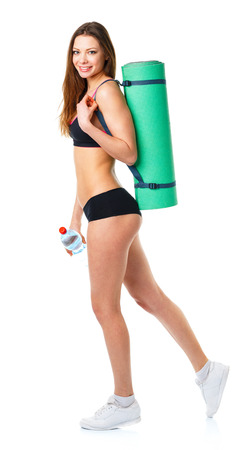 lift hands: Beautiful sport woman with mat for fitness and bottle of water isolated on white background Stock Photo