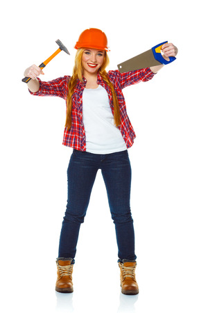 serrate: Young woman in helmet with a saw and hammer on a white background