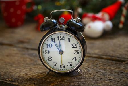 Vintage alarm clock on christmas background. Winter holidays background Stock Photo