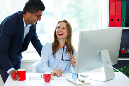 Beautiful young woman and man working from home - modern business concept photo