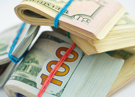 Success and got profit from business with pile of American dollars Stock Photo