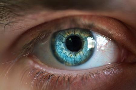 Beautiful blue male eye close-up
