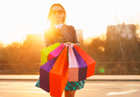 Woman holding her shopping bags in her hand - Lets go shopping concept