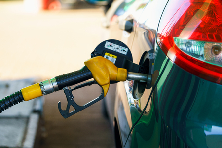 Car refueling on a petrol station closeup Stock Photo