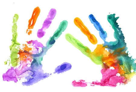 Multicolored hand prints on white background
