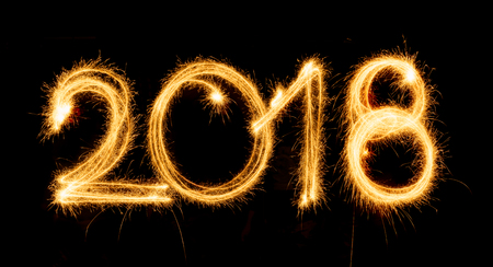 Happy New Year - 2018 with sparklers on black background Stock Photo