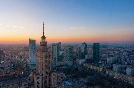 Aerial view of Warsaw business center: Palace of Science and Culture and skyscrapers at sunset