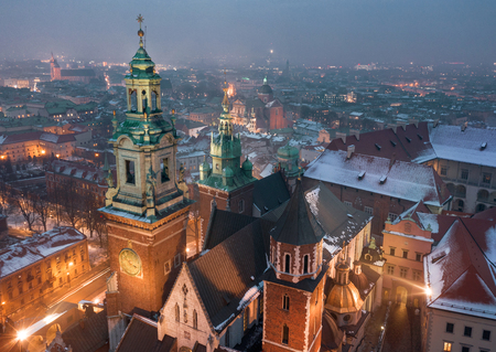 Aerial view of the historical center of Krakow, church, Wawel Royal Castle at night. Old town in winter