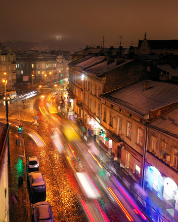 Aerial view of one of the central streets of Lviv at night. Blurred car lights Imagens