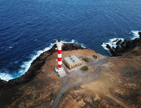 Aerial view of the lighthouse Faro de Rasca on The Tenerife, Canary Islands, Spain. Wild Coast of the Atlantic Ocean