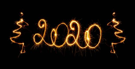 Happy New Year 2020 with sparklers on black background