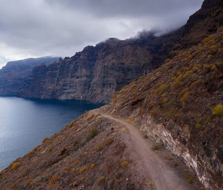 Los Gigantes Cliffs on Tenerife in cloudy weather, Canary Islands, Spain Imagens