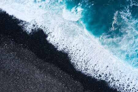 Aerial view of a deserted black volcanic beach. Coast of the island of Tenerife, Canary Islands, Spain. Imagens