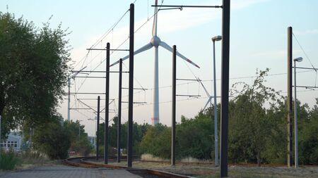 Eco power. Wind turbines generating electricity. Фото со стока