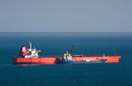 Bunkering tanker Nicholay Shalavin tanker Zaliv America. Nakhodka Bay. East (Japan) Sea. 30.03.2014