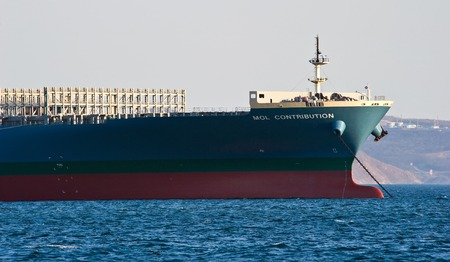 The bow of a huge container ship MOL Contribution anchored. Nakhodka Bay. East (Japan) Sea. 31.03.2014