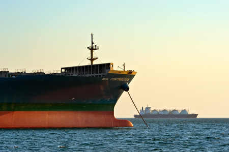 mol: The bow of a huge container ship MOL Contribution anchored. Nakhodka Bay. East (Japan) Sea. 31.03.2014 Editorial