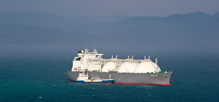 Tanker Nicholay Shalavin on raid bunkering anchored tanker Fuji LNG. Nakhodka Bay. East (Japan) Sea. 05.05.2014